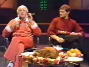 """Now then, this turkey wot we have got 'ere, and these very fine Christmas crackers, mean me and me old mucker Peter are all set to celebrate Christmas in some style. Lovely! But, you see, last year, the Duchess forgot to switch off the oven, so we had cinders for Christmas, and it wasn't a ball - let me tell you! Urrgh! Urrgh! Talking about cinders, here's a very talented young man by the name of David Bowie and his track is called 'Ashes to Ashes'. How's about that then?"""